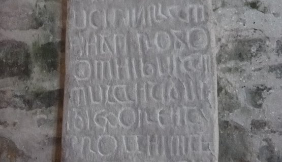 Ancient stone, Caldey Island - Latin and Ogham carved stone